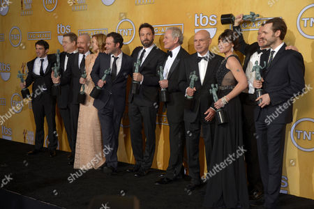 Winners of Outstanding Performance by a Cast in a Motion Picture For 'Argo' (l-r) Actors Chris Messina John Goodman Bryan Cranston Kerry Bishe Rory Cochrane Actor-director Ben Affleck Victor Garber Alan Arkin Clea Duvall Tate Donovan and Christopher Denham Pose at the 19th Annual Screen Actors Guild Awards at the Shrine Auditorium in Los Angeles California Usa 27 January 2013 United States Los Angeles