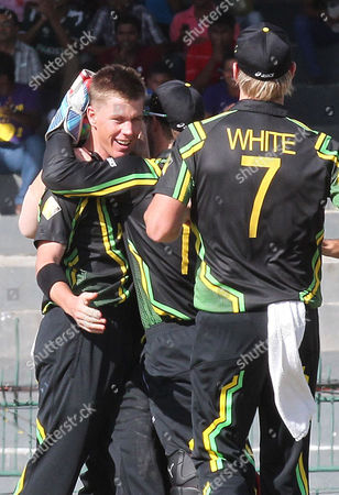 Australian Bowler Xavier Doherty (l) Celebrates with Teammates After Taking the Wicket of Richard Levi During the Super Eight Stage Match of the World Twenty20 Tournament Between South Africa and Australia at Colombo Sri Lanka on 30 September 2012 Sri Lanka Colombo