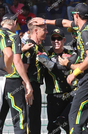 Australian Bowler Xavier Doherty (2l) Celebrates with Teammates After Taking the Wicket of Richard Levi During the Super Eight Stage Match of the World Twenty20 Tournament Between South Africa and Australia at Colombo Sri Lanka on 30 September 2012 Sri Lanka Colombo