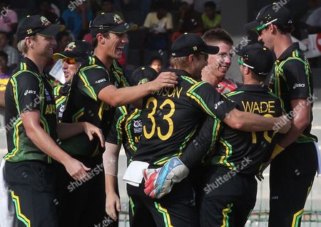 Australian Bowler Xavier Doherty (3r) Celebrates with Teammates After Taking the Wicket of Jacques Kallis During the Super Eight Stage Match of the World Twenty20 Tournament Between South Africa and Australia at Colombo Sri Lanka on 30 September 2012 Sri Lanka Colombo