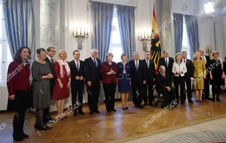 German President Joachim Gauck (C-R) with his partner Daniela Schadt (C) pose for a group picture with German Chancellor Angela Merkel (C-L) and her cabinet members at the New Year reception at Bellevue Palace in Berlin, Germany, 10 January 2017. Gauck received members of the public and over 70 citizens from different federal states who stand out for their dedication to society. Cabinet members are (L-R) State Minister for Migration, Refugees and Integration Aydan Oezoguz; Environment Minister Barbara Hendricks; Transport Minister Alexander Dobrindt; Minister for Family Affairs, Senior Citizens, Women and Youth Manuela Schwesig; Justice Minister Heiko Maas; Foreign Minister Frank-Walter Steinmeier; Interior Minister Thomas de Maiziere; Finance Minister Wolfgang Schaeuble; Agricultyure Minister Christian Schmidt; Defence Minister Ursula von der Leyen; Health Minister Hermann Groehe; Education Minister Johanna Wanka; Minister of the Chancellery Peter Altmeier; and State Minister for Culture and Media Monika Gruetters.