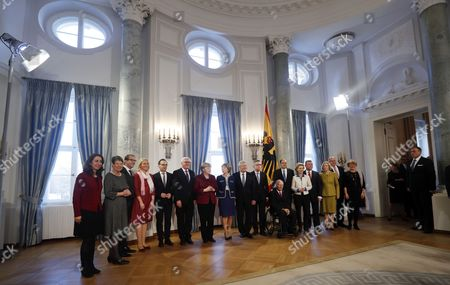 Stock Photo of German President Joachim Gauck (C-R) with his partner Daniela Schadt (C) pose for a group picture with German Chancellor Angela Merkel (C-L) and her cabinet members at the New Year reception at Bellevue Palace in Berlin, Germany, 10 January 2017. Gauck received members of the public and over 70 citizens from different federal states who stand out for their dedication to society. Cabinet members are (L-R) State Minister for Migration, Refugees and Integration Aydan Oezoguz; Environment Minister Barbara Hendricks; Transport Minister Alexander Dobrindt; Minister for Family Affairs, Senior Citizens, Women and Youth Manuela Schwesig; Justice Minister Heiko Maas; Foreign Minister Frank-Walter Steinmeier; Interior Minister Thomas de Maiziere; Finance Minister Wolfgang Schaeuble; Agricultyure Minister Christian Schmidt; Defence Minister Ursula von der Leyen; Health Minister Hermann Groehe; Education Minister Johanna Wanka; Minister of the Chancellery Peter Altmeier; and State Minister for Culture and Media Monika Gruetters.