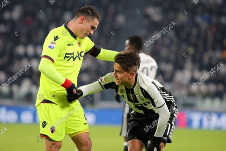 Paulo Dybala (right) and Federico Viviani (left) compete for the ball