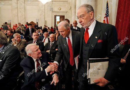 Jeff Sessions, Edwin Meese III, Chuck Grassley Attorney General-designate, Sen. Jeff Sessions, R-Ala., center, accompanied by Senate Judiciary Committee Chairman Sen. Charles Grassley, R-Iowa, right, reaches to shake hands with former Attorney General Edwin Meese III, as they arrive on Capitol Hill in Washington, for Sessions confirmation hearing before the committee