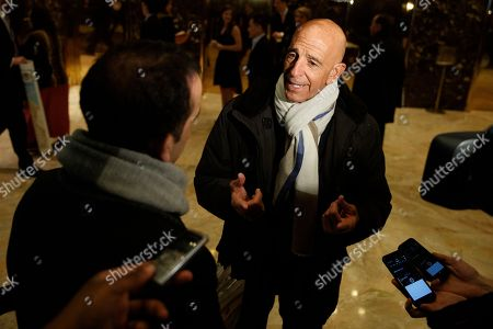 Tom Barrack, chairman of the inaugural committee, speaks with reporters in the lobby of Trump Tower in New York, before meeting with President-elect Donald Trump
