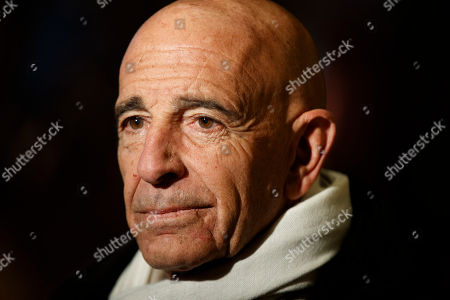 Stock Picture of Tom Barrack, chairman of the inaugural committee, speaks with reporters in the lobby of Trump Tower in New York, before meeting with President-elect Donald Trump