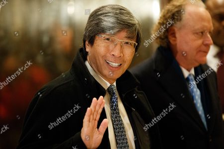 Dr. Patrick Soon-Shiong waves as he arrives in the lobby of Trump Tower in New York, for a meeting with President-elect Donald Trump