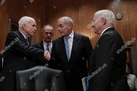 John Kelly, John McCain, Tom Carper, Robert Gates From left, Senate Armed Services Committee Chairman Sen. John McCain, R-Ariz., Sen. Tom Carper, D-Del., Homeland Security Secretary-designate John Kelly, and former Defense Secretary Robert Gates greet each other on Capitol Hill in Washington, prior to Kelly's confirmation hearing before the committee