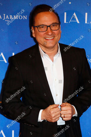 """Jean Marc Genereux poses for a photo call for the French premiere of """"La La Land"""" in Paris"""