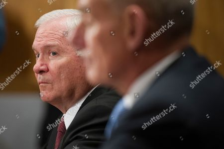 Former Former Secretary of Defense Robert Gates endorses retired Marine Gen. John F. Kelly during the Senate Homeland Security Committee hearing on Kelly's confirmation to be Secretary of Homeland Security on Capitol Hill in Washington
