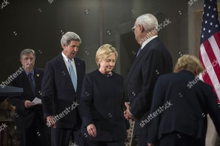 Stock Photo of US Secretary of State John Kerry (C-L) arrives with former Secretary of State Hillary Clinton (C) at the start of a reception celebrating the completion of the U.S. Diplomacy Center Pavilion at the US Department of State in Washington, DC, USA, 10 January 2017. Also pictured are former Secretary of State Colin Powell (2nd R) and former Secretary of State Madeleine Albright (R).