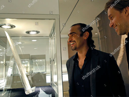"""Javier Munoz, David Korins Javier Munoz, who plays Alexander Hamilton in the Broadway megahit """"Hamilton,"""" and the musical's set designer David Korins, right, pore over documents written by or related to Hamilton, at Sotheby's auction house in New York. The artifacts, belonging to Hamilton's descendants, will be put on the auction block Jan. 18"""
