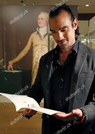 """Javier Munoz, who plays Alexander Hamilton in the hit Broadway musical, tears up as he reads a letter from Hamilton's son Patrick to his father that starts with the words """"Dear Papa,"""", in New York. The letter is among a trove of artifacts related to Alexander Hamilton, including love letters to his wife, Eliza, will be offered up for auction at Sotheby's Jan. 18. Hamilton set designer David Korins, who also helped Sotheby's on the Americana auction's space, of which the letters are a part, jokingly warned the Broadway star not to let his tears fall on Hamilton's delicate old letter paper"""