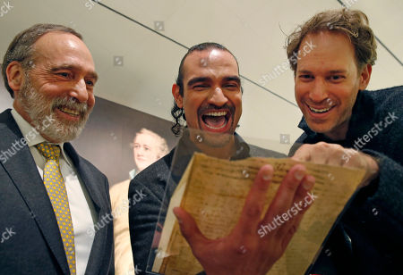 """Selby Kiffer, Javier Munoz, David Korins From left, Sotheby's books and manuscripts expert Selby Kiffer, Javier Munoz, center, who plays Alexander Hamilton in the Broadway musical megabit """"Hamilton,"""" laugh with the show's set designer David Korins as the trio read a letter from Hamilton, at Sotheby's auction house in New York. This and a trove of artifacts related to Alexander Hamilton, including love letters to his wife Eliza, will be offered up for auction at Sotheby's Jan. 18, part of """"Americana week."""" Munoz says holding and reading Hamilton's private thoughts about everything from his love life to war in America will have a deep effect on his Broadway performance"""
