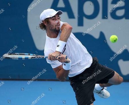 Matthew Barton of Australia plays a shot to Germany's Philipp Kohlschreiber during their men's singles match at the Sydney International tennis tournament in Sydney, Australia