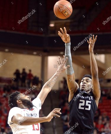 Kansas State forward Wesley Iwundu shoots while defended by Texas Tech forward Aaron Ross during the second half of an NCAA college basketball game, in Lubbock, Texas
