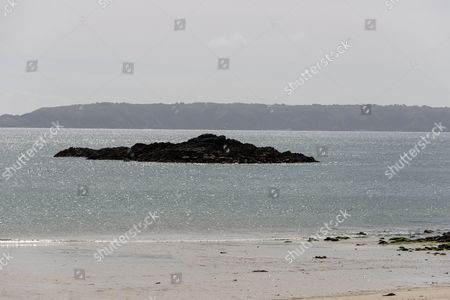 Rocky reefs at low tide on tShell Beach on the eastern shore of Herm Island, Channel Islands, Britain.