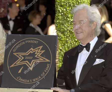 Film Tv and Theatre Actor Gordon Pinsent Poses with His Sidewalk Star After Being Inducted Onto Canada's Walk of Fame in Toronto Canada On 09 June 2007 the 10th Annual Walk of Fame Ceremony Honours Exemplary Canadians in the Arts Entertainment and Sports