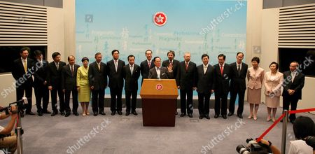 Donald Tsang Chief Executive of the Hong Kong Special Administrative Region (hksar) (c) Announces His New Cabinet in Hong Kong 23 June 2007 the Cabinet Members Are (l-r) Norman Chan Director of the Chief Executive Office Edward Yu Tang-wah Secretary For Environment Professor K C Chan Secretary For Financial Services and Treasury Matthew Cheung Kin-chung Secretary For Labour and Welfare Denise Yue Chung-yee Secretary For the Civil Service Ambrose Lee Siu-kwong Secretary For Security Frederick Ma Si-hang Secretary For Commerce and Economic Development Wong Yan Lung Secretary For Justice Henry Tang Ying-yen Chief Secretary John Tsang Chun-wah Financial Secretary Michael Suen Ming-yeung Secretary For Education Stephen Lam Sui-lung Secretary For Constitutional and Mainland Affairs Dr York Chow Secretary For Food and Health Tsang Tak-shing Secretary For Home Affairs Carrie Lam Yuet-ngor Secretary For Development Eva Cheng Secretary For Transport and Housing Lau Siu-kai Head of Central Policy Unit