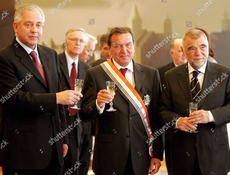(froml-r) Croatian Prime Minister Ivo Sanader Former German Chancellor Gerhard Schroder and Croatian President Stipe Mesic After Conferring of the Order Danica Starr with Ribbon to Schroeder Zagreb Croatia 24 April 2007 in the Memory of 15 Th Anniversary of Croatian Independence