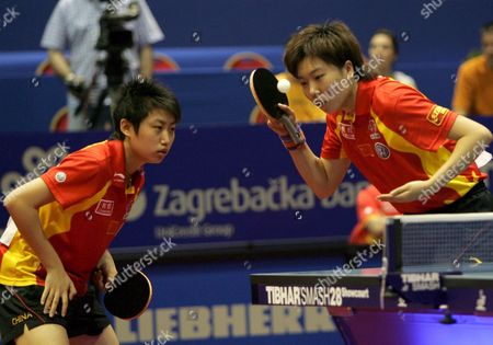 Xiaoxia Li (left) and Yue Guo of China Return a Ball to Their Opponents Ah Kyung Kim and Young Mi Park of Korea During the World Championships Women's Double Semi Final Table Tennis Match in Zagreb 27 May 2007