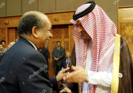 Saudi Arabian Foreign Minister Saud Al-faisal (r) Greets His Libyan Counterpart Abdel Rahman Shalgham During the Opening of the 26th Arab League Annual Meeting of Arab Foreign Ministers in Cairo Wednesday 06 September 2006 the Arab Foreign Ministers Are Tackling Issues in the Region Such As Terrorism Sudan Lebanon the Situation in Iraq and the Israeli Withdrawal From Occupied Palestinian Territories