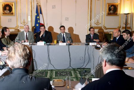 French Minister of Interior Nicolas Sarkozy (c) Accompanied by French Minister of Sports Jean-francois Lamour (2nd L) and Police Counsellor M Berlioz (l) Seat with Representatives of the French Soccer Community During a Meeting in Paris On Saturday 25 November 2006 Mr Sarkozy Met Representatives of Sports Associations and Police After a French Policeman Shot Dead a Supporter of Paris Soccer Club Paris Saint Germain