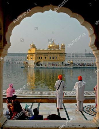 Sikh Devotees Pray in Front of the the Golden Temple On the Occasion of the Birth Anniversary of Sri Guru Nanak Dev Ji the First Guru of the Sikhs in Amritsar City Punjab India On Sunday 05 November 2006
