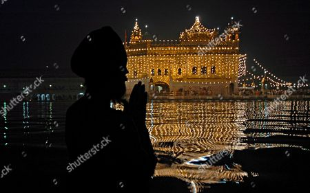 A Sikh Devotee Says His Early Morning Prayers As He Takes a Holy Dip in the Sacred Pond of the Golden Temple On the Occasion of the Birth Anniversary of Sri Guru Nanak Dev Ji the First Guru of the Sikhs in Amritsar City Punjab India On Sunday 05 November 2006