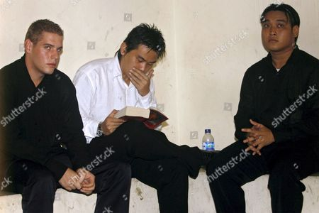 Australian Matthew Norman (l) Tan Duc Thanh Nguyen (r) and Si Yi Chen (c) Three of Six Australian Members of the 'Bali Nine' On Death Row Inside a Holding Cell Wait For Their Judicial Review Trial at Denpasar District Court in Bali Indonesia On 09 May 2007 Lawyers Are Arguing That Indonesia's Supreme Court Was Wrong When It Upgraded Their Sentences From 20 Years' Jail to the Death Penalty