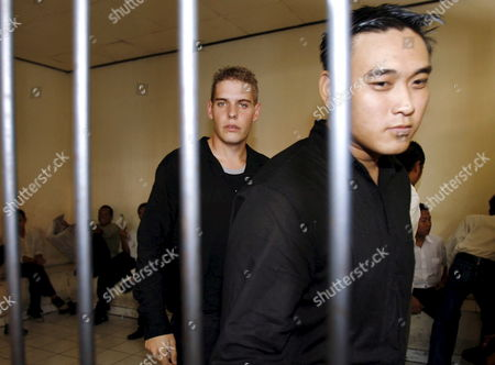 Australian Matthew Norman (l) and Tan Duc Thanh Nguyen (r) Two of Six Australian Members of the 'Bali Nine' On Death Row Inside a Holding Cell Before Their Judicial Review Trial at Denpasar District Court in Bali Indonesia On 25 June 2007 Lawyers Argued That Indonesia's Supreme Court Was Wrong When It Upgraded Their Sentences From 20 Years' Jail to the Death Penalty