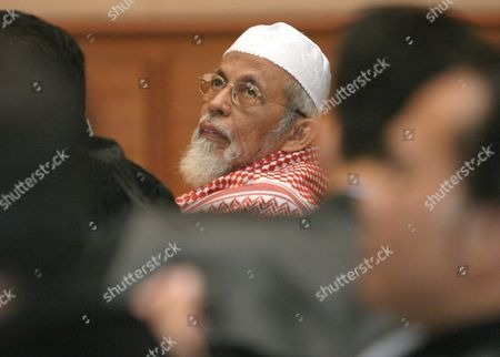 Indonesian Muslim Cleric Abu Bakar Ba'asyir Looks to His Lawyers As He Listens to a Testimony of Sutikno Alias Said Zaini at the Court Room in Jakarta Indonesia Thursday 16 December 2004 Ba'asyir Accused of Leading an Al Qaeda-linked Militant Network and of Planning Or Inciting the Group to Carry out Attacks in the World's Most Populous Muslim Nation