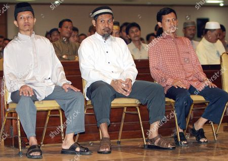 Indonesian Muslim Militant and Ji Member Imron Baihaki Alias Yuda Pranata (c) Looks at Indonesian Muslim Cleric Abu Bakar Ba'asyir Accompanied by Another Ji Members Sutikno (r) and Surono Satria (l) As They Give Testimony at the Court Room in Jakarta Indonesia Thursday 16 December 2004 Ba'asyir Accused of Leading an Al Qaeda-linked Militant Network and of Planning Or Inciting the Group to Carry out Attacks in the World's Most Populous Muslim Nation