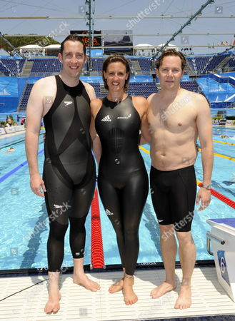 (l-r) Former British Swimmers Stephen Parry Wearing a Speedo Lzr Racer Suit with Panels of Non-permeable Material Karen Pickering Wearing a New Adidas Suit Made of Non-permeable Material and James Hickman Wearing a Textile Jammer Pose Poolside at the 13th Fina World Championships at the Foro Italico Complex in Rome Italy on 30 July 2009 Fina the World Swimming Body Decided to Go Back to Textile Swimsuits Italy Rome