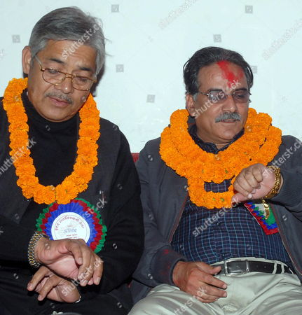 Nepal's Communist Maoist Rebel Leader Prachanda (r) and Cpn-uml Leader Bamdev Gautam (l) Check Their Watches Before They Leave For High-level Peace Talks with the Government in Kathmandu Monday 06 November 2006 On Sunday Rebel Leader Prachanda Said On State-run Television That His Fighters Who Control Large Swathes of the Countryside Would Place Their Weapons Under the Watchful Eye of Un Monitors the Formal Announcements Are Expected to Come After Today's High-level Peace Talk
