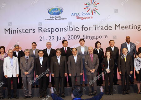 Trade Ministers From 21 Asia-pacific Economic Cooperation (apec) Economies Line Up For a Group Photograph During Their Meeting in Singapore 21 July 2009 (front L-r) Canada's Minister of International Trade Stockwell Day Chile's Vice-minister of Trade Carlos Furche China's Minister of Commerce Chen Deming Peru's Minister of Foreign Trade & Tourism Martin Perez Singapore's Minister For Trade and Industry Lim Hng Kiang World Trade Organisation Director General Pascal Lamy Japan's Vice Minister For Foreign Affairs Hashimoto Seiko and Director General For Trade Policy Okada Hideichi Hong Kong's Secretary For Commerce and Economic Development Rita Lau (back L-r) Indonesia's Minister For Trade Mari E Pangestu Mexico's Secretary of Economy Ing Gerado Ruiz Mateos New Zealand's Minister of Trade Tim Groser Philippines' Secretary of Trade and Industry Peter Favila Russia's Vice Minister For Economic Development Andrey Siepnev Thailand's Minister of Commerce Porntiva Nakasai Taiwan's Minister of Economic Affairs Yiin Chii-ming United States Trade Representative Ronald Kirk