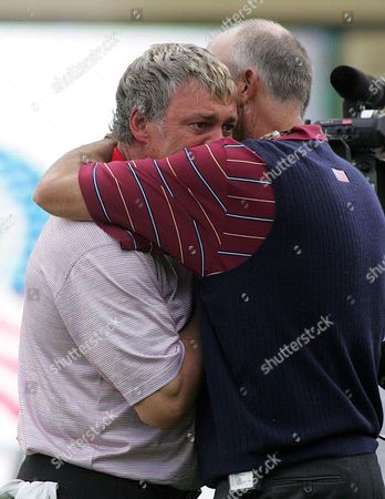 Stock Picture of European Ryder Cup Player Darren Clark (r) of Northern Ireland Recieves a Hug From American Ryder Cup Captain Tom Lehman(l) After the European Ryder Cup Team Defeated the American Ryder Cup Team On the Final Day of the 2006 Ryder Cup at the K Club Near Dublin Sunday 24 September 2006 the European Ryder Cup Team Defeated the Americans to Retain the Ryder Cup For the Third Consecutive Year