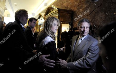 Miss California Carrie Prejean (2-r) is Escorted by Her Father Will (r) and Others Following a Press Conference where Us Entrepreneur Donald Trump Who Owns the Miss Usa Pageant Announced That Prejean Can Retain Her Title As Miss California in New York New York Usa On 12 May 2009 Prejean Failed to Reveal That She Had Posed in Her Underwear As a Teenager Before Last Month's Miss Usa Pageant