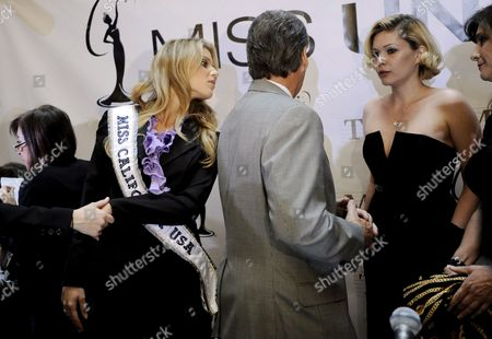 Stock Photo of Miss California Carrie Prejean (2-l) Looks Toward Her Father Will (3-r) and Mother Francine (r) As Well As Shanna Moakley (2-r) Executive Director of Miss California Usa Following a Press Conference where Us Entrepreneur Donald Trump Who Owns the Miss Usa Pageant Announced That Prejean Can Retain Her Title As Miss California in New York New York Usa On 12 May 2009 Prejean Failed to Reveal That She Had Posed in Her Underwear As a Teenager Before Last Month's Miss Usa Pageant