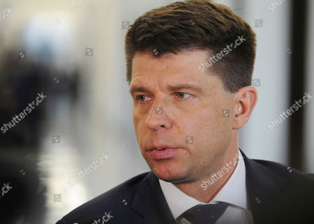Ryszard Petru, leader of one of the opposition parties, the Nowoczesna (Modern) speaks to journalists in the parliament in Warsaw, Poland, . The parliament's session hall is occupied by a group of opposition lawmakers as they continue a protest since Dec.16, 2016 against the policies of the ruling Law and Justice party, causing delay of the first session of 2017
