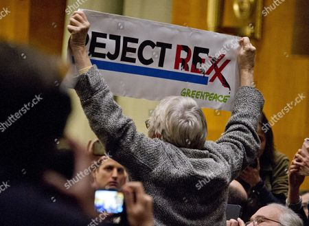 A protestor interrupts the United States Senate Committee on Foreign Relations hearing considering the nomination of Rex Wayne Tillerson, former chairman and chief executive officer of ExxonMobil to be Secretary of State of the US