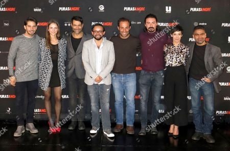 "Stock Photo of The cast and director of the Mexican film ""Purasangre"" pose for a portrait during a press conference in Mexico City. From left, the actors Ruy Senderos, Paulette Hernandez and Luis Roberto Guzman, the director Noe Santillan-Lopez, actors Mauricio Arguelles, Cesar Rodriguez, Fernanda Borches and Adrian Vazquez. The film about a group of thieves that steals an hippodrome premieres on Friday, Jan. 13 in Mexico"