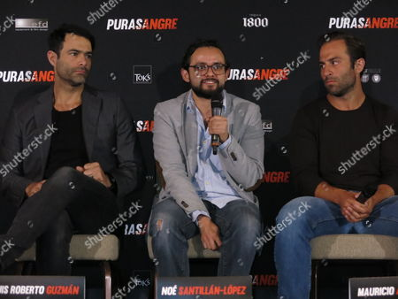 "Stock Picture of The director of the Mexican film ""Purasangre"" Noe Santillan-Lopez, center, speaks during a press conference in Mexico City, while actors Luis Roberto Guzman, left, and Mauricio Arguelles listen. The film about a group of thieves at a race track premieres on Friday, Jan. 13 in Mexico"