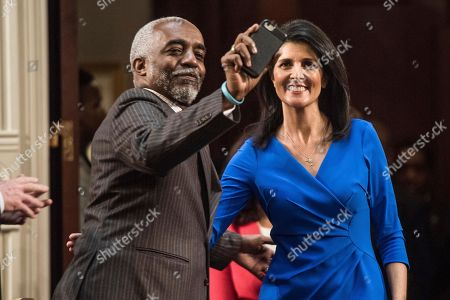 Nikki Haley, Terry Alexander Rep. Terry Alexander, D-Florence, left, takes a selfie with South Carolina Gov. Nikki Haley during introductions before her delivery of the state of the state in the House chamber at the South Carolina Statehouse, in Columbia, S.C