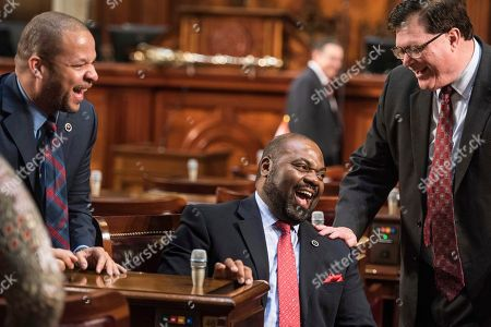 Samuel Rivers, Jay Lucas, John King Rep. Samuel Rivers, R-Berkeley, center, laughs with Rep. Jay Lucas, R-Darlington, right, and Rep John King, D-York, left, before the state of the state address by Gov. Nikki Haley at the state Capitol, in Columbia, S.C
