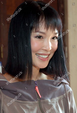 Singapore Movie Star Fann Wong Smiles During a Visit to Blind Children in a Center in Phnom Penh Cambodia Friday 03 November 2006 Fann is On a Two-day Visit in Cambodia to Take a Part in the Giant Concert in Phnom Penh As a Part of Water Festival