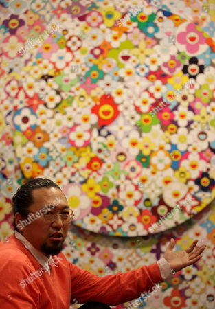 Japanese Artist Takashi Murakami Poses in Front of His Work of Art During the 'Louis Vuitton: a Passion For Creation' Exhibition at the Hong Kong Museum of Art in Hong Kong China 21 May 2009 the Exhibition Features a Selection of Works From the Fondation Louis Vuitton Pour La Creation Including a Number of Large-scale Works Sculptures Photographs and Installations by Internationally Known Artists Such As Jean-michel Basquiat Cao Fei Paul Chan Gilbert and George Dominique Gonzalez-foerster Andreas Gursky Pierre Huyghe Jeff Koons Bertrand Lavier Christian Marclay Richard Prince and Yang Fudong Works by Established and Newly Discovered International Artists Working in the Medium of Video Will Also Be Shown