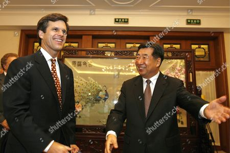 Timothy Shriver (l) Ceo and President of Special Olympics International Walks with Chinese Vice Premier Hui Liangyu (r) Before the Closing of the 2006 Special Olympics World Summer Games Head of Delegation Seminar Held Sunday 15 October in Shanghai During the Shanghai Initational Games 3 000 Athletes From 20 Countries Are in Sanghai For the 2006 Invitational Games Which Take Place From 13 October to 19 October and Are a Test-run For the 2007 Special Olympics World Summer Games