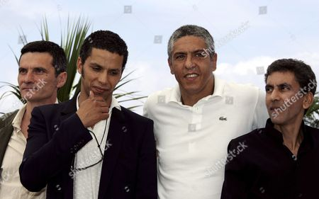 French Director Rachid Bouchareb (r) Poses with French Actors (l-r) Bernard Blancan Sami Bouajila and Samy Naceri During a Photo Call For Their Film 'Indigenes' Running in Competition at the 59th Cannes Film Festival Thursday 25 May 2006 in Cannes