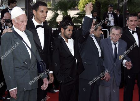 French Actors Roschdy Zem (2nd L) Jamel Debbouze (3rd L) and Bernard Blancan (r) and French Director Rachid Bouchareb (3rd R) Pose with War Veterans As They Arrive at the Palais Des Festivals For the Screening of Their Film 'Indigenes' Running in Competition at the 59th Cannes Film Festival Thursday 25 May 2006 in Cannes